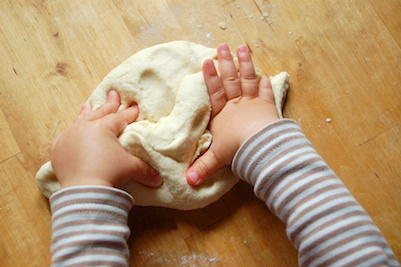 Child Playing in Dough