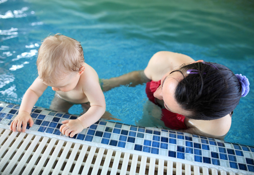 Woman with baby in pool